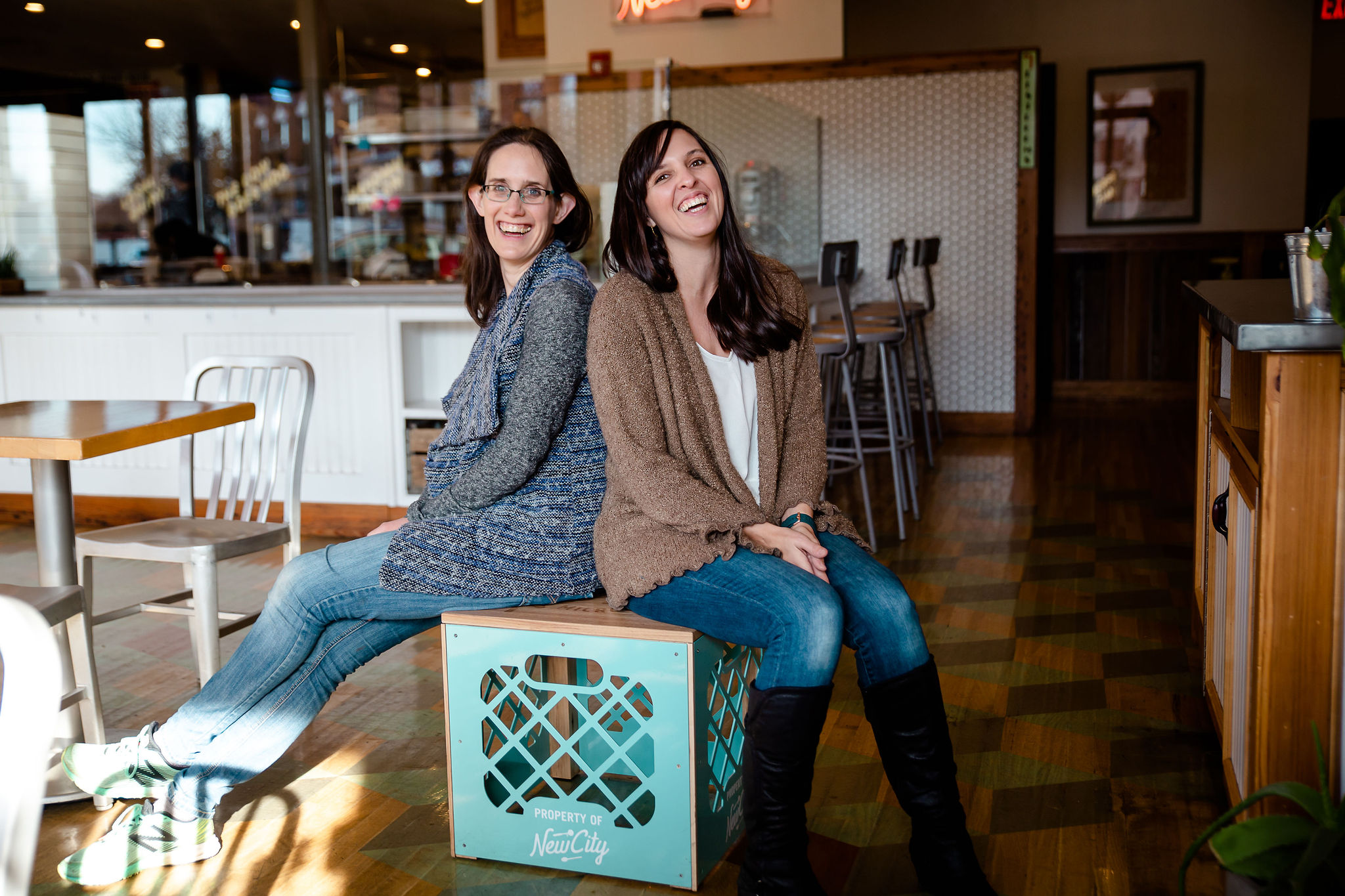 Becca and Bethany sitting at New City Microcreamery in Hudson ready to meet new parents for a consult